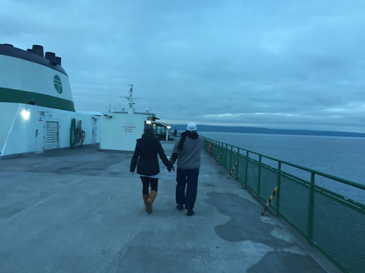 couple walking on edmonds-kingston ferry
