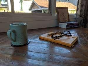 journal with mug and glasses